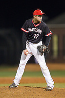 Davidson Wildcats relief pitcher Ryan Lowe (17) looks to his catcher for the sign against the Wake Forest Demon Deacons at Wilson Field on March 19, 2014 in Davidson, North Carolina.  The Wildcats defeated the Demon Deacons 7-6.  (Brian Westerholt/Four Seam Images)