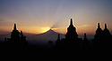 A view of the Merapi Volcano from Borobudur, Java, Indonesia at sunrise.  Photo by, Karie Henderson © 2001