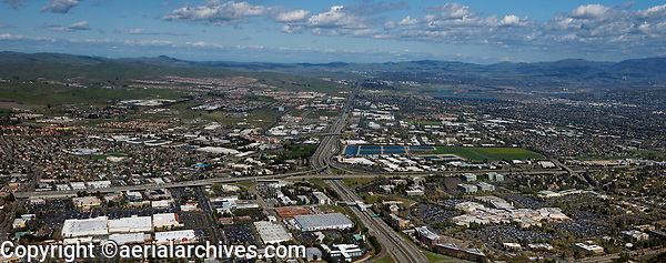 aerial photograph of the intersection of I-580 and I-680 at Pleasanton; the Stoneridge Shopping Center foreground right, Dublin and Livermore in the background, Alameda County, California