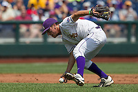 Louisiana State shortstop Alex Bregman (30) reaches for a ground ball against the North Carolina Tar Heels during Game 7 of the 2013 Men's College World Series on June 18, 2013 at TD Ameritrade Park in Omaha, Nebraska. The Tar Heels defeated the Tigers 4-2, eliminating LSU from the tournament. (Andrew Woolley/Four Seam Images)