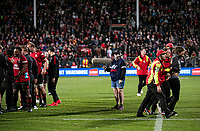 A pitch invader is led off after the 2021 Super Rugby Aotearoa final between the Crusaders and Chiefs at Orangetheory Stadium in Christchurch, New Zealand on Saturday, 8 May 2021. Photo: Joe Johnson / lintottphoto.co.nz