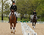LEXINGTON, KY - APRIL 28: #10 Bango and rider Tim Price (left) and $9 Fernhill By Night and rider Elisabeth Halliday-Sharp (right) in the warm up ring before their Dressage test in the Rolex Three Day Event, Dressage Day 1, at the Kentucky Horse Park in Lexington, KY.  April 28, 2016 in Lexington, Kentucky. (Photo by Candice Chavez/Eclipse Sportswire/Getty Images)