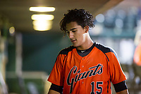 AZL Giants catcher Ricardo Genoves (15) in the dugout between innings of a game against the AZL Cubs on September 5, 2017 at Scottsdale Stadium in Scottsdale, Arizona. AZL Cubs defeated the AZL Giants 10-4 to take a 1-0 lead in the Arizona League Championship Series. (Zachary Lucy/Four Seam Images)