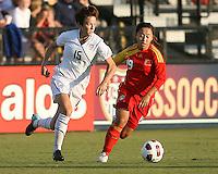 Megan Rapinoe #15 of the USA WNT pushes past Shanshan Qu #19 of the PRC WNT during an international friendly match at KSU Soccer Stadium, on October 2 2010 in Kennesaw, Georgia. USA won 2-1.