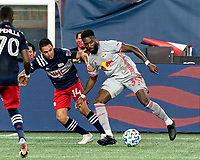 FOXBOROUGH, MA - AUGUST 29: Mandela Egbo #39 of New York Red Bulls dribbles as Diego Fagundez #14 of New England Revolution defends during a game between New York Red Bulls and New England Revolution at Gillette Stadium on August 29, 2020 in Foxborough, Massachusetts.