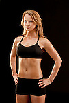 Young muscular woman facing forward, hands on hips