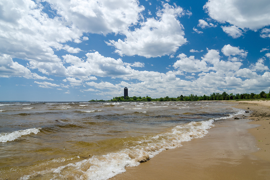 A beautiful summer day on Big Bay de Noc - Lake Michigan. The historic Nahma burner can been seen in the distance. Nahma, MI