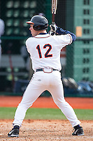 Charlie Cody (12) of the Virginia Cavaliers at bat against the Hartford Hawks at The Ripken Experience on February 27, 2015 in Myrtle Beach, South Carolina.  The Cavaliers defeated the Hawks 5-1.  (Brian Westerholt/Four Seam Images)