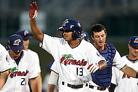 Fort Myers Miracle pinch hitter Aderlin Mejia (13) high fives teammates after a walk off base hit during a game against the St. Lucie Mets on April 19, 2015 at Hammond Stadium in Fort Myers, Florida.  Fort Myers defeated St. Lucie 3-2 in eleven innings.  (Mike Janes/Four Seam Images)