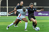 BRIDGEVIEW, IL - JULY 18: Tziarra King #23 of the OL Reign and Kealia Watt #2 of the Chicago Red Stars battle for the ball during a game between OL Reign and Chicago Red Stars at SeatGeek Stadium on July 18, 2021 in Bridgeview, Illinois.