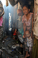 Families live in dire poverty just a kilometer from the cenre of  Rangoon, Burma, NOV 2008. <br /> <br /> Photo by Richard Jones