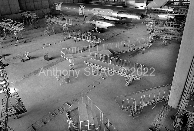 """Samara, Russia  .October 1997.""""Aviacor""""-Russian joint stock company produces and repairs TU-154M passenger planes. In the ghost like hanger for painting the planes nothing moves as there are no more orders and work has simply stopped.."""