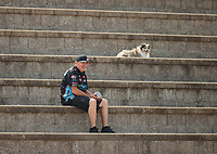 Jul 29, 2018; Sonoma, CA, USA; NHRA top fuel driver Scott Palmer with his dogs during the Sonoma Nationals at Sonoma Raceway. Mandatory Credit: Mark J. Rebilas-USA TODAY Sports