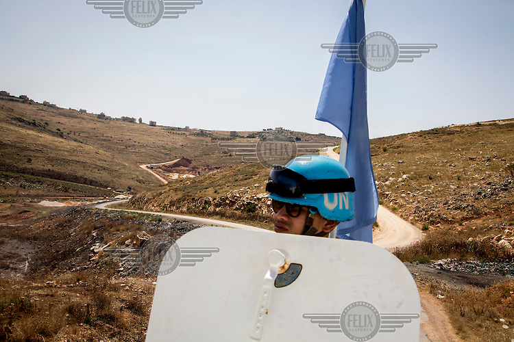 UN peacekeepers patrolling in an armoured vehicle along the Blue Line, the border demarcation between Lebanon and Israel, in south Lebanon.