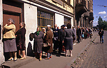 Riga Latvia  men women form a long queue outside an alcohol shop waiting for it to open 1989.