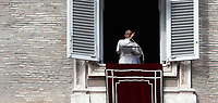 Papa Francesco benedice i fedeli in piazza San Piatro dalla finestra del suo studio durante l'Angelus domenicale, Citta' del Vaticano, 12 novembre, 2017.<br /> Pope Francis blesses faithful during the Sunday Angelus noon prayer from the window of his studio overlooking St. Peter's Square, at the Vatican, on November 12, 2017.<br /> UPDATE IMAGES PRESS/IsabellaBonotto<br /> <br /> STRICTLY ONLY FOR EDITORIAL USE