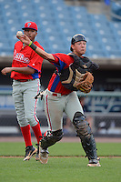 Catcher Drew Lugbauer (50) of Arlington High School in Pleasant Valley, New York playing for the Philadelphia Phillies scout team throws to first as pitcher William Rios (21) backs up the play during the East Coast Pro Showcase on July 31, 2013 at NBT Bank Stadium in Syracuse, New York.  (Mike Janes/Four Seam Images)