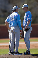 Pitching coach Scott Forbes (21) of the North Carolina Tar Heels chats with starting pitcher Garrett Davis (20) at the 2008 Coca-Cola Classic at the Winthrop Ballpark in Rock Hill, SC, Sunday, March 2, 2008.