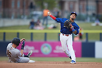 Kannapolis Cannon Ballers shortstop Jose Rodriguez (12) forces out Curtis Mead (16) of the Charleston RiverDogs at second base at Atrium Health Ballpark on July 1, 2021 in Kannapolis, North Carolina. (Brian Westerholt/Four Seam Images)