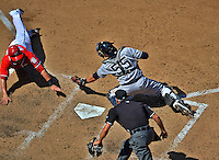 16 June 2012: Washington Nationals' first baseman Tyler Moore slides home on an Adam LaRoche pinch-hit single as New York Yankees catcher Russell Martin tags the sliding Moore in the 8th inning at Nationals Park in Washington, DC. Moore was called out on the play, which would have broken a 3-3 tie. The Yankees went on to defeat the Nationals in 14 innings by a score of 5-3, taking the second game of their 3-game series. Mandatory Credit: Ed Wolfstein Photo