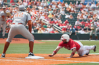 Houston Cougars shortstop Frankie Ratcliff (7) dives back to first base as Texas Longhorns first baseman Kacy Clemens (42) waits to catch the pick off throw during the NCAA baseball game on June 6, 2014 at UFCU Disch–Falk Field in Austin, Texas. The Longhorns defeated the Cougars 4-2 in Game 1 of the NCAA Super Regional. (Andrew Woolley/Four Seam Images)