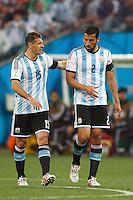 Martin Demichelis and Ezequiel Garay of Argentina