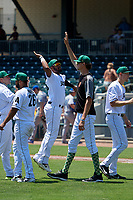 Augusta GreenJackets Mikey Edie (46) jumps to high five Sean Hjelle (54) after a South Atlantic League game against the Lexington Legends on April 30, 2019 at SRP Park in Augusta, Georgia.  Augusta defeated Lexington 5-1.  (Mike Janes/Four Seam Images)