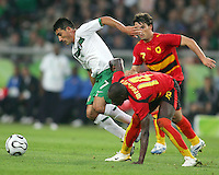 Zinha (7) of Mexico escapes from Menonca (14) and Figueiredo (7) of Angola. Mexico and Angola played to a 0-0 tie in their FIFA World Cup Group D match at FIFA World Cup Stadium, Hanover, Germany, June 16, 2006.