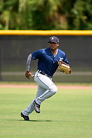 FCL Tigers East outfielder Lazaro Benitez (10) during practice before a game against the FCL Yankees on July 27, 2021 at the Yankees Minor League Complex in Tampa, Florida. (Mike Janes/Four Seam Images)