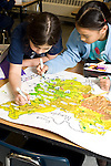Education Elementary School Grade 3 two girls working together on map project