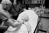 Chicago, Illinois<br /> USA<br /> December 17, 2009<br /> <br /> At the University of Chicago Medical Center Geraldine Martin, 80 years old, is prepared for open heart surgery to have a valve replaced and hole repaired. She is accompanied by her sister Helen Martin prior to the surgery. A nurse marks the spot of where the incision is to be made.