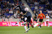 Carlos Valdes (5) of the Philadelphia Union falls over Dane Richards (19) of the New York Red Bulls. The New York Red Bulls defeated the Philadelphia Union  1-0 during a Major League Soccer (MLS) match at Red Bull Arena in Harrison, NJ, on October 20, 2011.