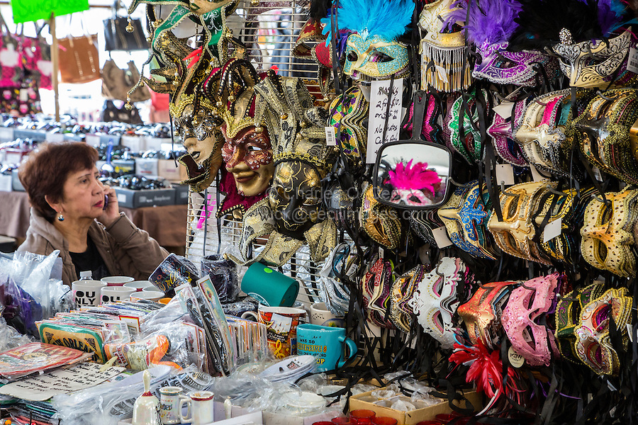French Quarter, New Orleans, Louisiana.  Vendor with Mardi Gras Masks for Sale in the French Market.