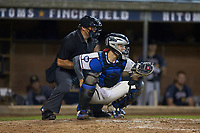 High Point-Thomasville HiToms catcher Rudy Maxwell (25) (Duke) sets a target as home plate umpire Brett Stowe looks on during the game against the Wilson Tobs at Finch Field on July 17, 2020 in Thomasville, NC. The Tobs defeated the HiToms 2-1. (Brian Westerholt/Four Seam Images)