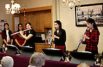 Waterbury, CT- 01 December 2016-120116CM01- Members of the Bennett family of Cheshire including from left, Kathryn, Susanna and Carolyn perform Christmas music for residents and staff at the Middlebury Convalescent Home on Friday.  The family played the classic tunes using various instruments.   Christopher Massa Republican-American
