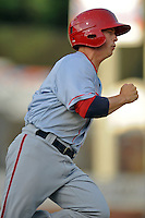 Hagerstown Suns second baseman Tony Renda #7 runs to first during a game against the Asheville Tourists at McCormick Field on May 28, 2013 in Asheville, North Carolina. The Tourists won the game 9-4. (Tony Farlow/Four Seam Images)