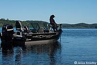 Young angler boat fishing
