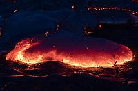 A lava toe glows on the Kilauea coastal plains in Pulama Pali, Puna district, Hawai'i Island, early New Year's Day 2018.