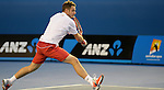 Stanislaus Wawrinka (SUI) defeats Novak Djokovic (SRB) 2-6, 6-4, 6-2, 3-6, 9-7 at the Australian Open in Melbourne, Australia on January 21, 2014