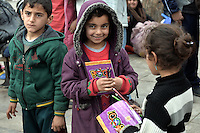Pictured: Young migrant children Friday 26 February 2016<br /> Re: Hundreds of refugees have temporarily camped at Victoria Square in central Athens, Greece.