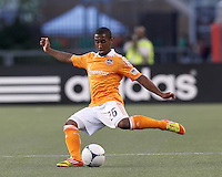 Houston Dynamo defender Corey Ashe (26) passes the ball. In a Major League Soccer (MLS) match, the New England Revolution tied Houston Dynamo, 2-2, at Gillette Stadium on May 19, 2012.