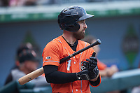 Mason McCoy (1) of the Norfolk Tides waits for his turn to hit during the game against the Charlotte Knights at Truist Field on May 14, 2021 in Charlotte, North Carolina. (Brian Westerholt/Four Seam Images)