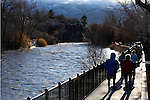 Hundreds of people came out to watch the surging Truckee River, in downtown Reno, Nev., on Sunday, Dec. 2, 2012, as a heavy, wet storm hit the Northern Nevada region. The storm delivered more snow and less rain than forecast, blunting the flood danger. (AP Photo/Cathleen Allison)