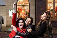 Pictured: Three young women wave to the camera. Sunday 31 December 2017 and 01 January 2018<br /> Re: New Year revellers in Wind Street, Swansea, Wales, UK
