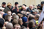© Joel Goodman - 07973 332324 . 02/04/2011 . Blackburn , UK . In-fighting breaks out amongst EDL supporters . The English Defence League ( EDL ) hold a demonstration in Blackburn . Photo credit : Joel Goodman