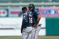 Reno Aces Yasmany Tomas (23) talks to Domingo Leyba (26) during a pitching change in a game against the Fresno Grizzlies at Chukchansi Park on April 8, 2019 in Fresno, California. Fresno defeated Reno 7-6. (Zachary Lucy/Four Seam Images)