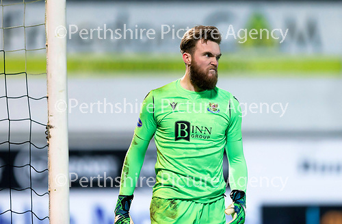 Dunfermline v St Johnstone…15.12.20   East End Park      BetFred Cup<br />Zander Clark reacts after saving pars first penalty<br />Picture by Graeme Hart.<br />Copyright Perthshire Picture Agency<br />Tel: 01738 623350  Mobile: 07990 594431