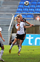Rachel Buehler vies for a header against a German player. The USA captured the 2010 Algarve Cup title by defeating Germany 3-2, at Estadio Algarve on March 3, 2010.