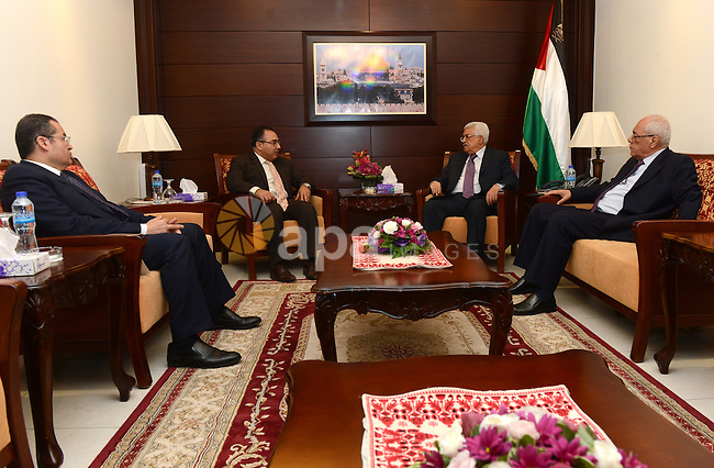 Palestinian President Mahmoud Abbas meets with the Egyptian ambassador Wael Nasreddine, in the West Bank city of Ramallah on July 1, 2015. Photo by Thaer Ganaim