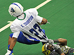 Alabama Hammers' Willie McDowell stops Nighthawks' Kelvin Thompson (23) by his shirttail.  Alabama Hammers vs. Knoxville Nighthawks indoor football at Von Braun Center Propst Arena. The Huntsville TImes/Bob Gathany)